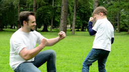 middle aged father plays with son (little boy) - park Footage
