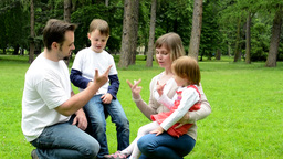 Parents (mother And Father) Teach Children (boy And Girl) To Count On The Finger stock footage