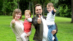 family (middle couple in love, cute girl and small boy) show thumbs on agreement Footage