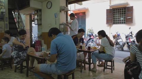 street restaurant hanoi - people eating Live Action