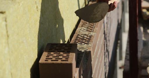 Construction. Man lays bricks Footage