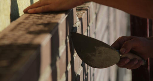 Construction. Man lays bricks. Close up Footage