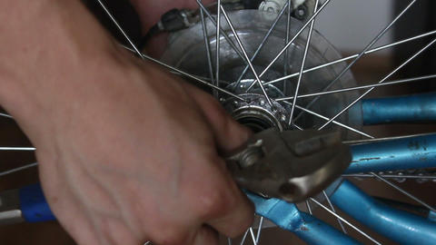Disassembly bicycle wheel , unscrewing Live Action