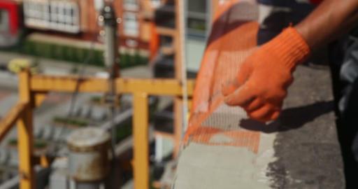 Construction. Man strengthen construction netting Stock Video Footage