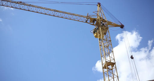 Construction. Crane Against The Sky With Clouds stock footage