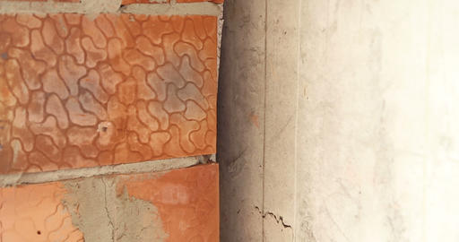 Construction. The Joint Between The Brick Wall And Concrete Wall. Close Up stock footage