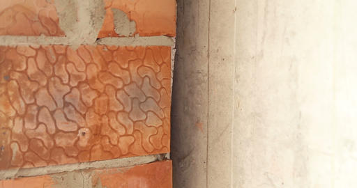 Construction. The joint between the brick wall and… Stock Video Footage