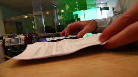 Bank customer signs the document Live Action