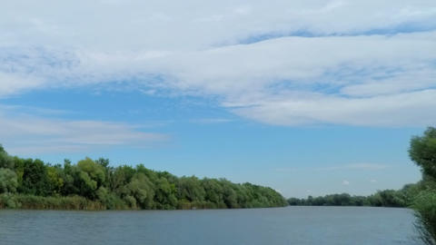 White Fluffy Clouds Over The River stock footage