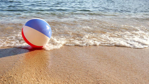 Beach Ball At The Mercy Of The Waves 4k stock footage