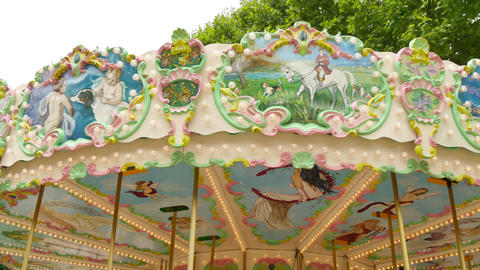 Classical Pretty Fairground Carousel in France 4k Live Action
