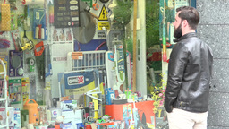 PRAGUE, CZECH REPUBLIC - MAY 30, 2015: Young Handsome Hipster Man Looks To Shop  stock footage