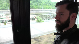 PRAGUE, CZECH REPUBLIC - MAY 30, 2015: Young Handsome Hipster Man Travel By Bus  stock footage