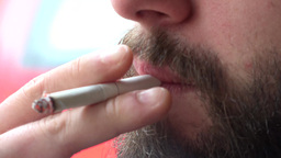 young hipster man smokes a cigarette - closeup mouth Footage