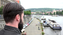 Young Handsome Hipster Man Looks From Bridge - River With Boats - Waterfront - S stock footage