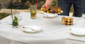 A Dining Table In The Street, Covered With Food stock footage