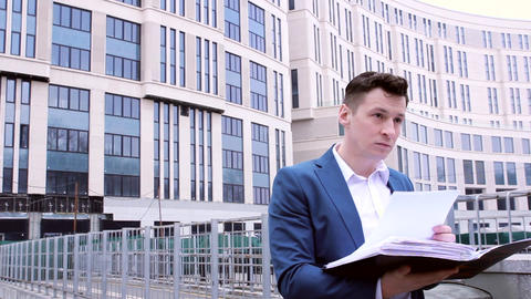 Businessman In A Suit And White Shirt Reading Business Papers stock footage