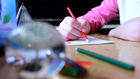 the girl draws with crayons. girl and pen Footage