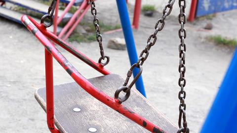 empty swings in a playground Footage