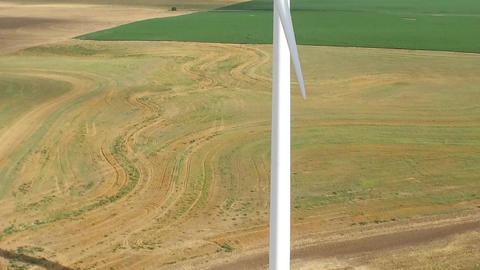 Wind Turbine Pan Up Aerial Live Action