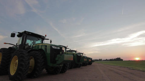 Row of John Deere Tractors Sunset Live Action
