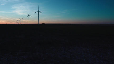 Wind Turbines Far View Pan Down Sunset Live Action