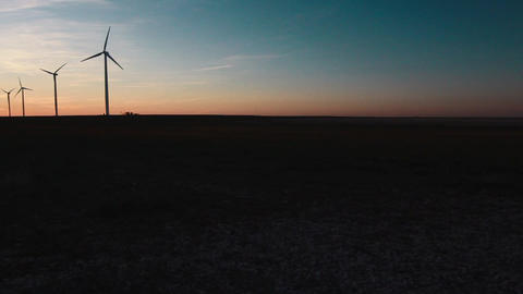 Wind Turbines Far View Pan Left Sunset Live Action