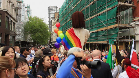 Birmingham Gay Pride - Big Puppet Of Jesus Above The Crowd stock footage