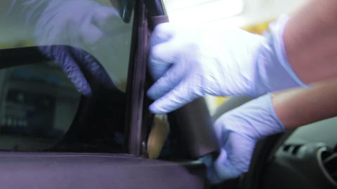 Car service station: dismantling the car door for the creation soundproofing Footage