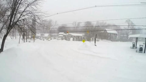 Busy Intersection Snowstorm Timelapse stock footage