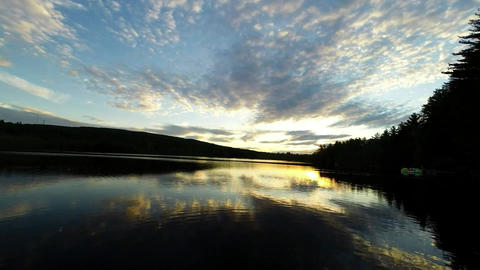 Panning Sunset Timelapse Over Pond stock footage