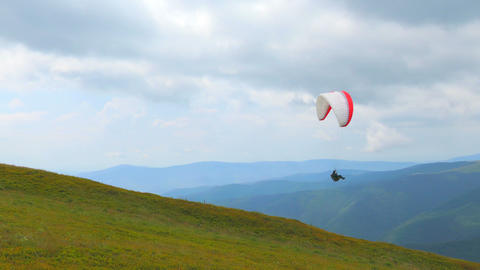 4k, Paraglider Flying High In The Mountains stock footage