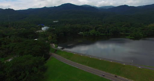 aerial - scooters drive by Chiang Mai university lake Footage