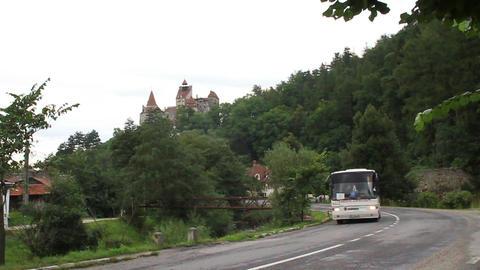 Romania. Bran. Dracula castle. Bus on road Footage