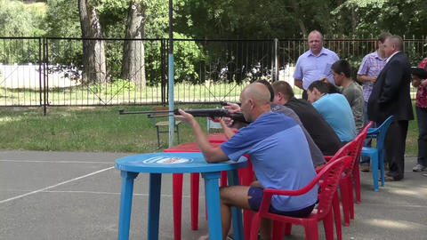 Men compete in shooting from a pneumatic Footage