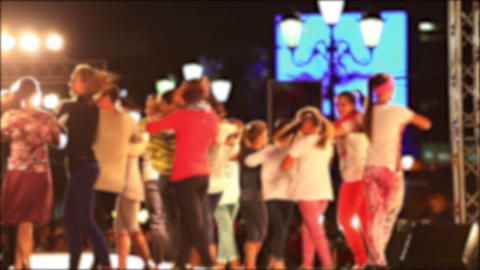 Group of children and teenagers dancing on the stage of dynamic dance. No focus Live Action