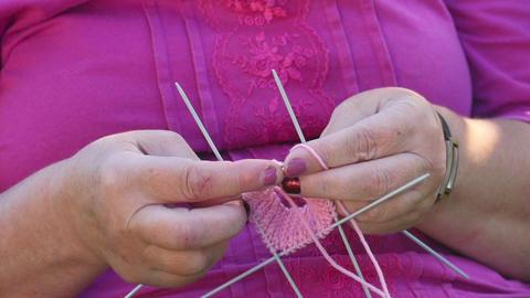 Knitting socks Footage