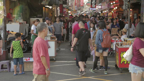 Shoppers strolling through Danshui market entrance Footage