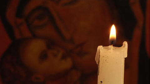 candle and Christian Orthodox icon Footage