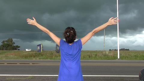 Woman watching Storm Footage