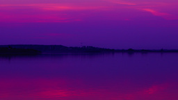 Pink sunset over lake, pan, time lapse Footage