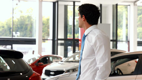 Businessman looking at the selection of cars Stock Video Footage
