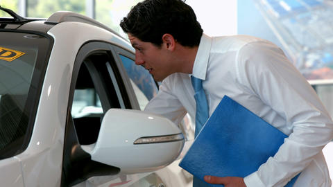 Businessman checking out a car Live Action