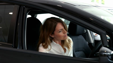 Businesswoman checking out a car Footage