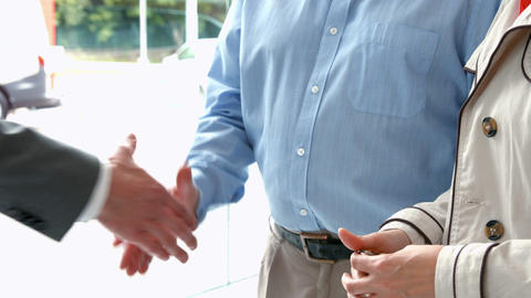 Couple taking keys from businessman Live Action