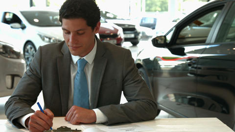 Businessman siging some documents Footage