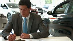 Businessman siging some documents, Live Action