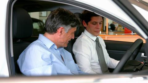 Businessman explaining the car details Stock Video Footage