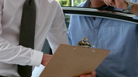Businessman explaining the car details Live Action