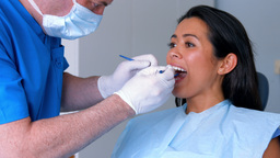 Patient getting their teeth examined Footage